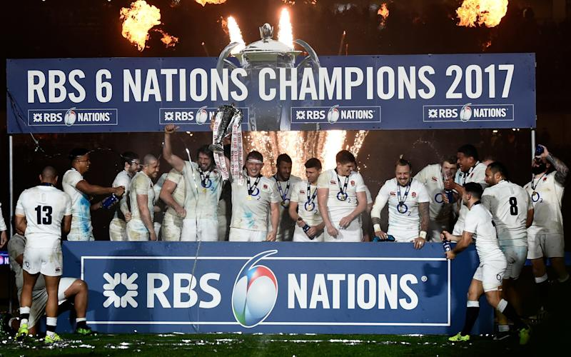 England collected the Six Nations trophy at the Aviva Stadium
