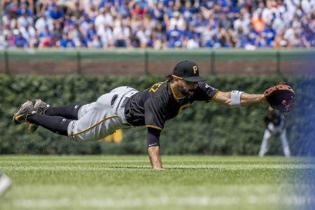Jun 9, 2018; Chicago, IL, USA; Pittsburgh Pirates second baseman Sean Rodriguez (3) attempts to catch a ground ball hit by Chicago Cubs center fielder Ian Happ (not pictured) during the fourth inning at Wrigley Field. Mandatory Credit: Patrick Gorski-USA TODAY Sports