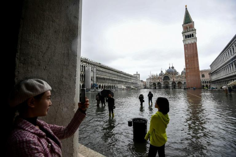 Extreme weather events also saw floods in Venice this year (AFP Photo/Miguel MEDINA)