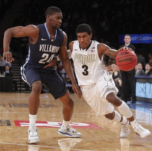 Purdue's Ronnie Johnson (3) drives past Villanova's Achraf Yacoubou (24) during the first half of their NCAA college basketball game in the 2K Sports Classic at Madison Square Garden, Thursday, Nov. 15, 2012, in New York. (AP Photo/Jason DeCrow)