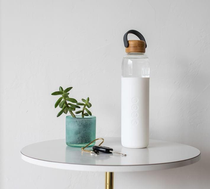 <p>This <span>Soma Glass Water Bottle</span> ($35) will easily fit into your everyday tote or car cupholder. It's made from shatter-resistant glass and it features a natural bamboo cap with handle for easy grip. The best part? Every bottle purchased supports a nonprofit that's fighting for safe water drinking globally.</p>