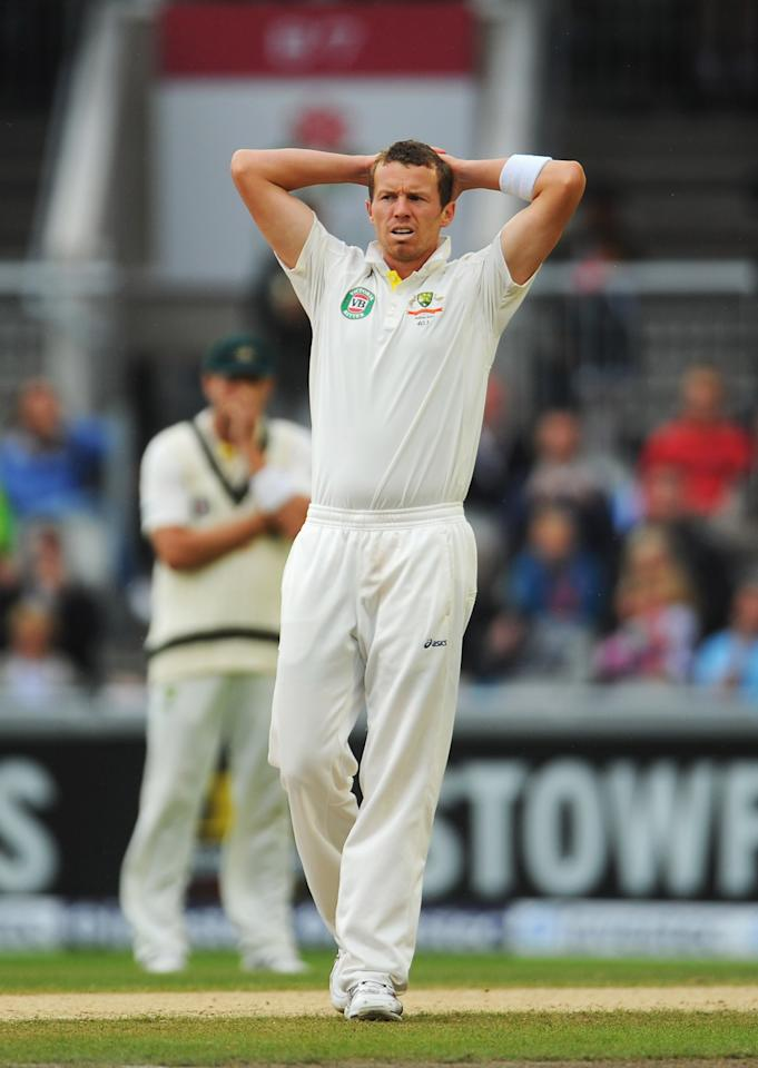 MANCHESTER, ENGLAND - AUGUST 05: Peter Siddle of Australia looks dejected after Ian Bell of England edged a delivery over the slips during day five of the 3rd Investec Ashes Test match between England and Australia at Emirates Old Trafford Cricket Ground on August 5, 2013 in Manchester, England. (Photo by Stu Forster/Getty Images)