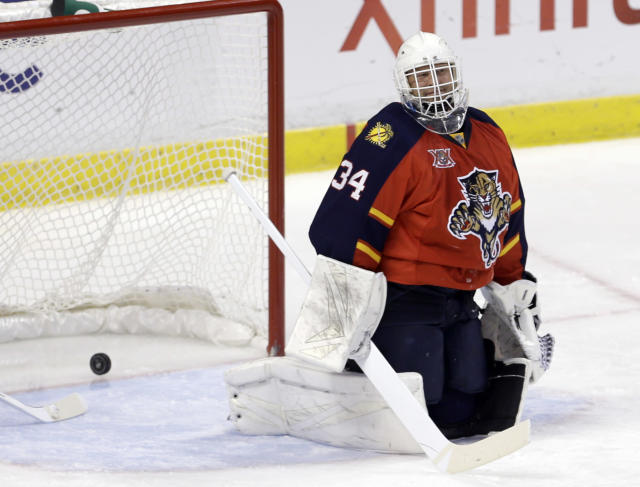 Florida Panthers goalie Tim Thomas (34) reacts after Minnesota Wild defenseman Jonas Brodin (25) scored in the second period of an NHL hockey game, Saturday, Oct. 19, 2013, in Sunrise, Fla. (AP Photo/Alan Diaz)