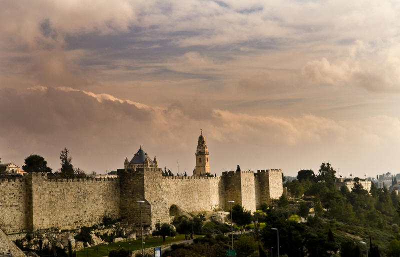 The old city wall and Mt. Zion during sunset.
