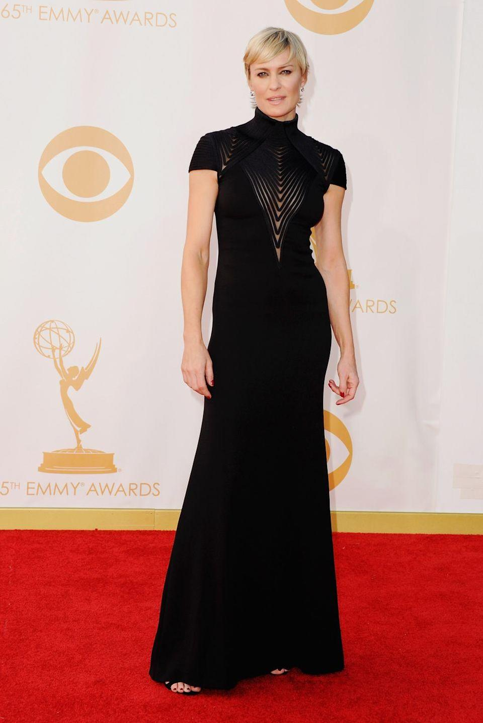 <p>Claire Underwood would approve of Wright's amazing black dress at the Emmy Awards in 2013.</p>