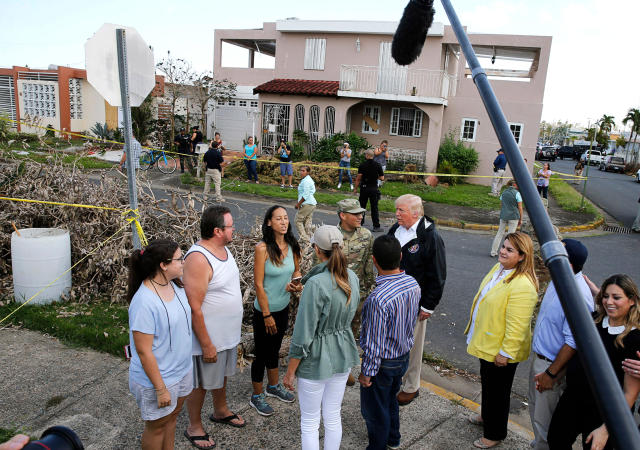<p>President Donald Trump talks with local residents during a walking tour with first lady Melania Trump of areas damaged by Hurricane Maria in Guaynabo, Puerto Rico, Oct. 3, 2017. (Photo: Jonathan Ernst/Reuters) </p>