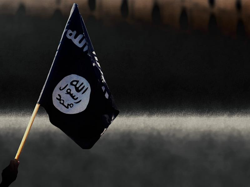 Man waves black flag used by Islamic State of Iraq and the Levant insurgents, Mosul, Iraq, on texture, partial graphic