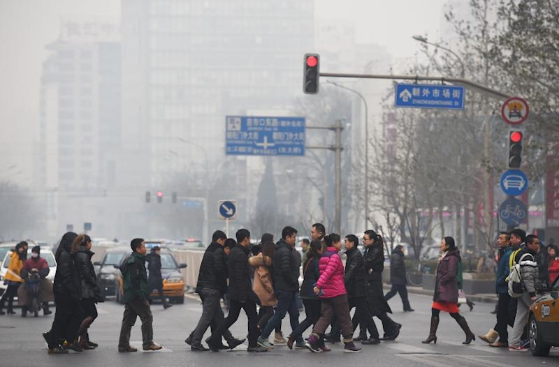 China's cities are often hit by heavy pollution, blamed on coal-burning by power stations and industry, as well as vehicle use (AFP Photo/Greg Baker)