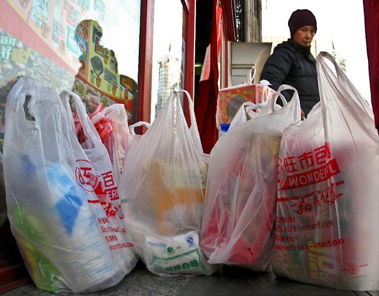Plastic shopping bags each have a carbon footprint of 10 gCO2e (AFP Photo/Teh Eng Koon)