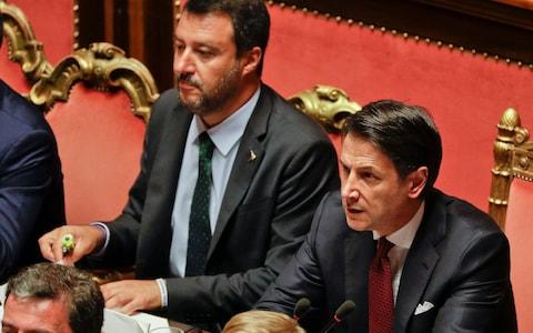 Italian Premier Giuseppe Conte, right, is flanked by Deputy-Premier Matteo Salvini as he addresses the Senate in Rome, Tuesday, Aug. 20, 2019. - Credit: Gregorio Borgia/AP