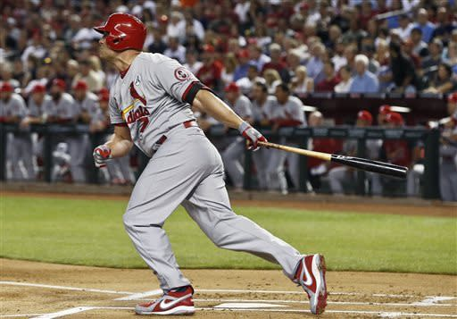St. Louis Cardinals' Matt Holliday connects on an RBI double against the Arizona Diamondbacks in the first inning during an opening day baseball game Monday, April 1, 2013, in Phoenix. (AP Photo/Ross D. Franklin)