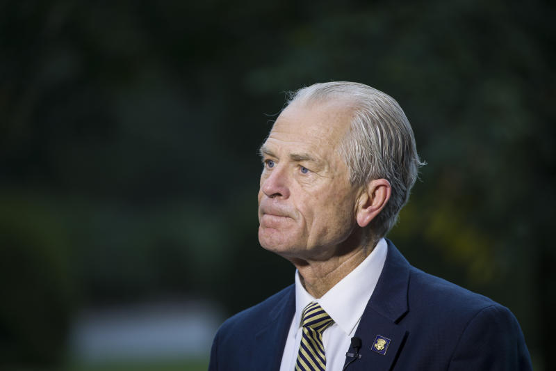 In this Wednesday, Sept. 11, 2019 file photo, White House trade adviser Peter Navarro pauses while speaking during a television interview at the White House in Washington. The US administration is threatening to pull the United States out of the 145-year-old Universal Postal Union, complaining that some postal carriers like China's aren't paying enough to have foreign shipments delivered on the final stretch to reach U.S. recipients. A special Universal Postal Union congress take place from Tuesday Sept. 24, to Thursday, Sept. 25, 2019 in Geneva Switzerland(AP Photo/Alex Brandon)