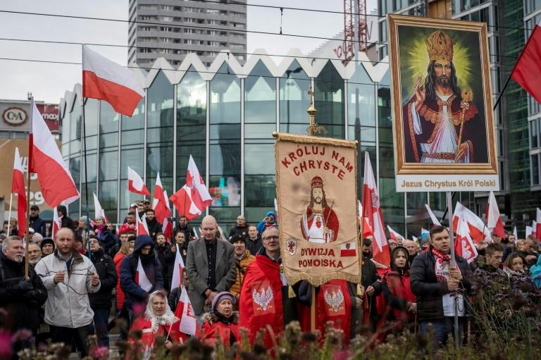 Catholics carrying religious symbols joined the march