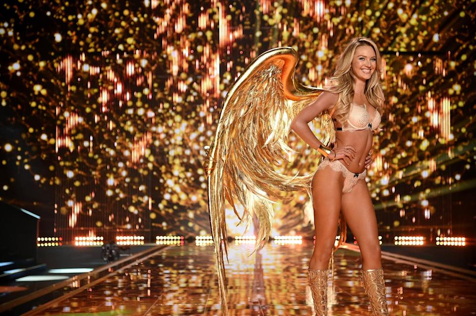 <p>Candice Swanepoel looked a million dollars in this all gold look in 2014. [Photo: Getty] </p>