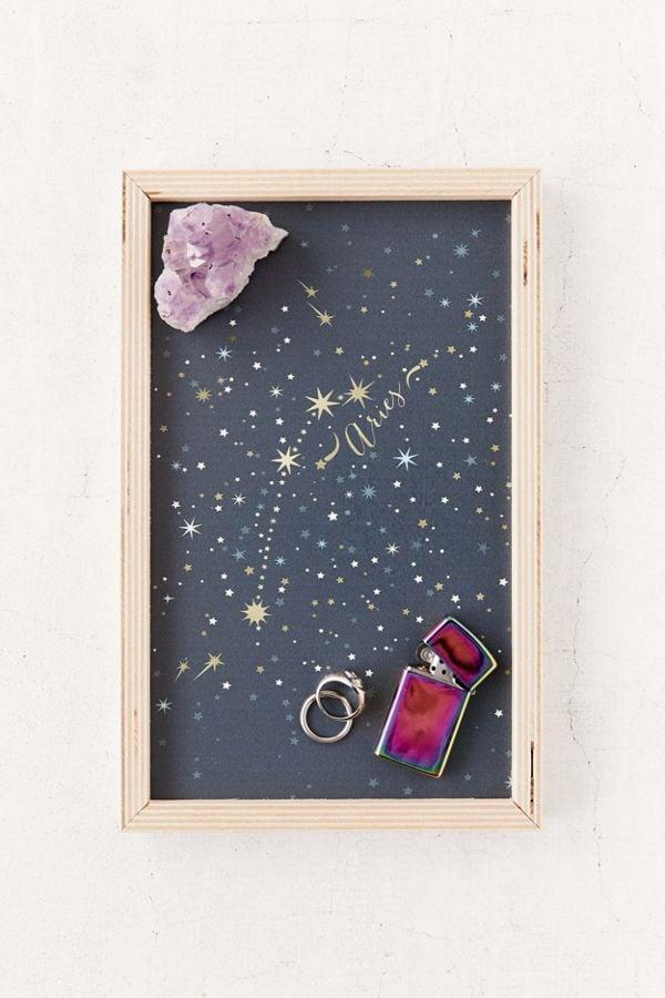 "<p>Instead of placing letters and bills in a pile, designate a tray for them. We like this <a href=""https://www.popsugar.com/buy/Iveta-Abolina-Deny-Constellation-Wooden-Tray-537953?p_name=Iveta%20Abolina%20For%20Deny%20Constellation%20Wooden%20Tray&retailer=urbanoutfitters.com&pid=537953&price=24&evar1=savvy%3Aus&evar9=45668938&evar98=https%3A%2F%2Fwww.popsugar.com%2Fhome%2Fphoto-gallery%2F45668938%2Fimage%2F47083124%2FIveta-Abolina-For-Deny-Constellation-Wooden-Tray&list1=new%20years%20resolutions%2Corganization%2Cproductivity%2Chome%20life%2Cmarie%20kondo%2Chome%20shopping&prop13=api&pdata=1"" rel=""nofollow"" data-shoppable-link=""1"" target=""_blank"" class=""ga-track"" data-ga-category=""Related"" data-ga-label=""https://www.urbanoutfitters.com/shop/iveta-abolina-for-deny-constellation-wooden-tray?category=SEARCHRESULTS&amp;color=801"" data-ga-action=""In-Line Links"">Iveta Abolina For Deny Constellation Wooden Tray</a> ($24).</p>"
