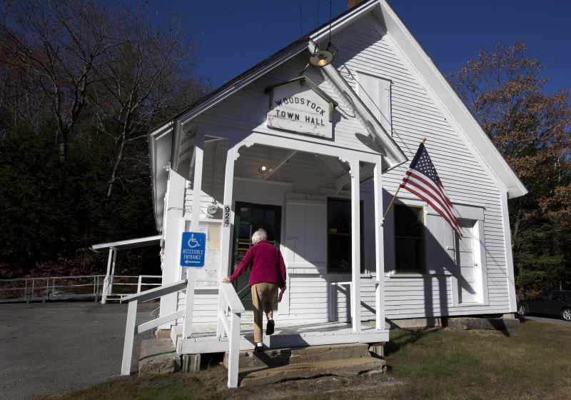 A voter arrives to vote at the town hall on Nov. 8, 2016, in Woodstock, N.H. (Photo: Jim Cole/AP)