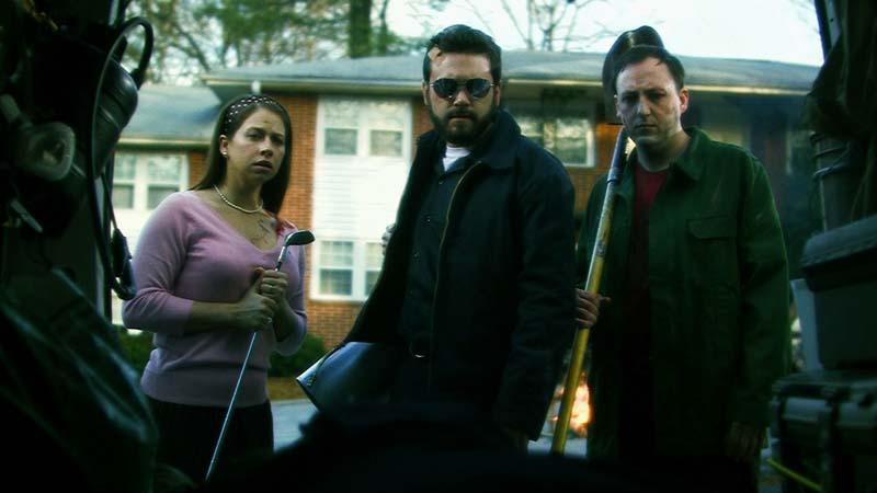 A still from the Signal shows three people looking into the camera