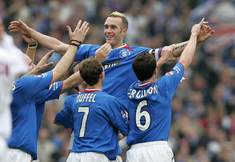 Rangers Fernando Ricksen celebrates with Maurice Ross Thomas Buffel and Barry Ferguson after scoring against Motherwell. Rangers Fernando Ricksen celebrates with Maurice Ross Thomas Buffel (L) and Barry Ferguson (R) after scoring against Motherwell during the Scottish League Cup Final at Hampden Glasgow March 20, 2005. REUTERS/Jeff J Mitchell REUTERS