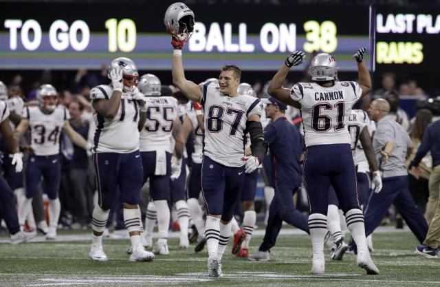 """FILE - In this Feb. 3, 2019, file photo, New England Patriots' Rob Gronkowski (87) celebrates with teammates after the NFL Super Bowl 53 football game against the Los Angeles Rams in Atlanta. The Patriots won 13-3. Gronkowski says he is retiring from the NFL after nine seasons. Gronkowski announced his decision via a post on Instagram Sunday, March 24, 2019, saying that a few months shy of this 30th birthday """"its time to move forward and move forward with a big smile."""" (AP Photo/Carolyn Kaster, File)"""