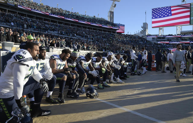 <p>Seattle Seahawks players kneel during the national anthem before the first half of an NFL football game against the Jacksonville Jaguars, Sunday, Dec. 10, 2017, in Jacksonville, Fla. (AP Photo/Phelan M. Ebenhack) </p>