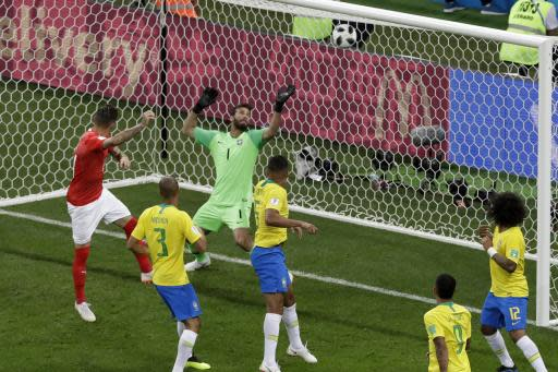 Switzerland's Steven Zuber, left, scores his side's first goal during the group E match between Brazil and Switzerland at the 2018 soccer World Cup in the Rostov Arena in Rostov-on-Don, Russia, Sunday, June 17, 2018. (AP Photo/Andrew Medichini)