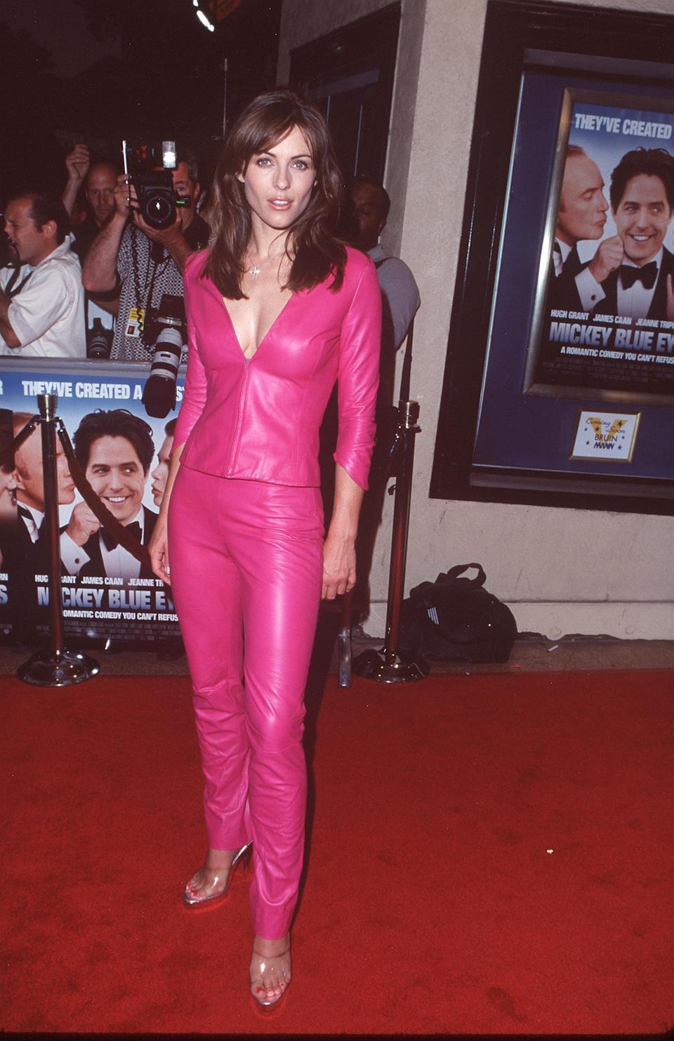 """<p>Actress and model <a class=""""link rapid-noclick-resp"""" href=""""https://www.popsugar.com/Elizabeth-Hurley"""" rel=""""nofollow noopener"""" target=""""_blank"""" data-ylk=""""slk:Elizabeth Hurley"""">Elizabeth Hurley</a> walked in this stunning pink leather outfit at the <strong>Mickey Blue Eyes </strong>premiere so that <a href=""""https://www.popsugar.com/fashion/reese-witherspoon-legally-blonde-style-47680011"""" class=""""link rapid-noclick-resp"""" rel=""""nofollow noopener"""" target=""""_blank"""" data-ylk=""""slk:Elle Woods"""">Elle Woods</a> could run in <strong>Legally Blonde</strong>. </p>"""