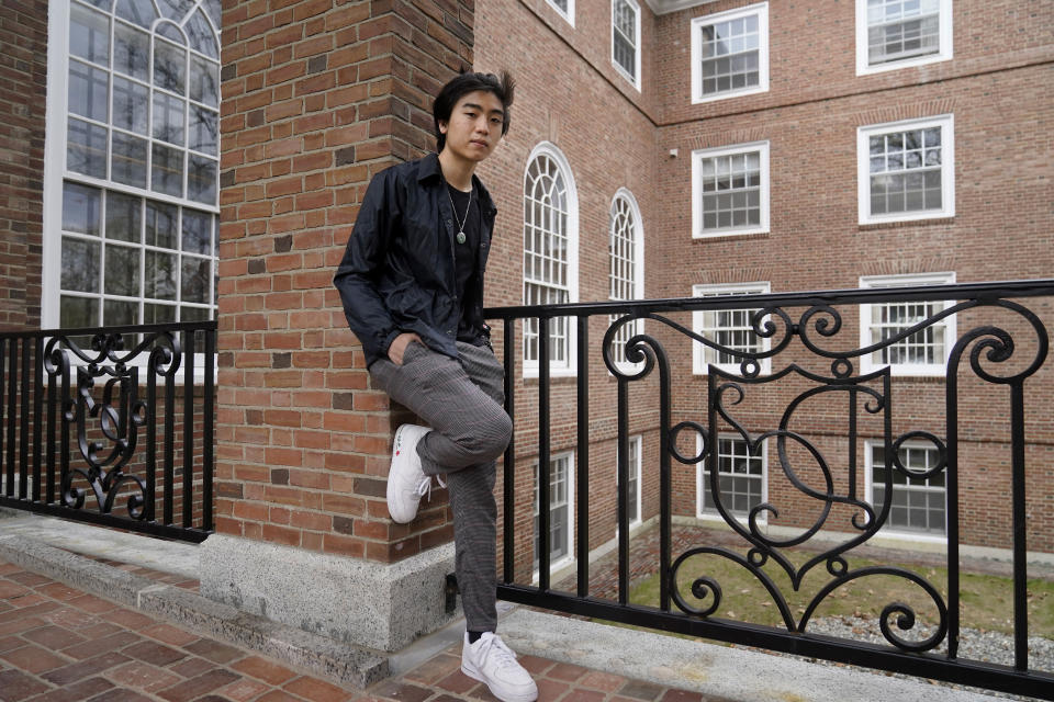 Nicholas Sugiarto, of San Diego, Calif., a student at Dartmouth College, stands for a photograph on the school's campus, Tuesday, April 20, 2021, in Hanover, N.H. A wave of anti-Asian attacks that started more than a year ago with the pandemic, along with the March 2021 shootings in Atlanta that left six Asian women dead, have provoked national conversations about the visibility of Asian Americans. (AP Photo/Steven Senne)