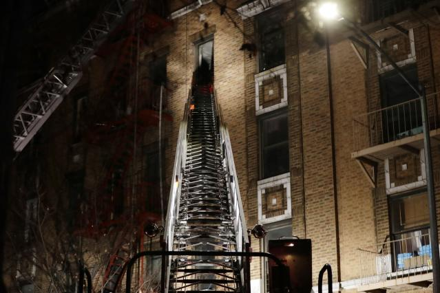 <p>Firefighters respond to a deadly fire Thursday, Dec. 28, 2017, in the Bronx borough of New York. (Photo: Frank Franklin II/AP) </p>