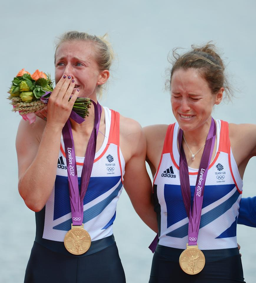 WINDSOR, ENGLAND - AUGUST 04:  Katherine Copeland and Sophie Hosking of Great Britain celebrate with their gold medals during the medal ceremony for the Lightweight Women's Double Sculls Final on Day 8 of the London 2012 Olympic Games at Eton Dorney on August 4, 2012 in Windsor, England.  (Photo by Harry How/Getty Images)