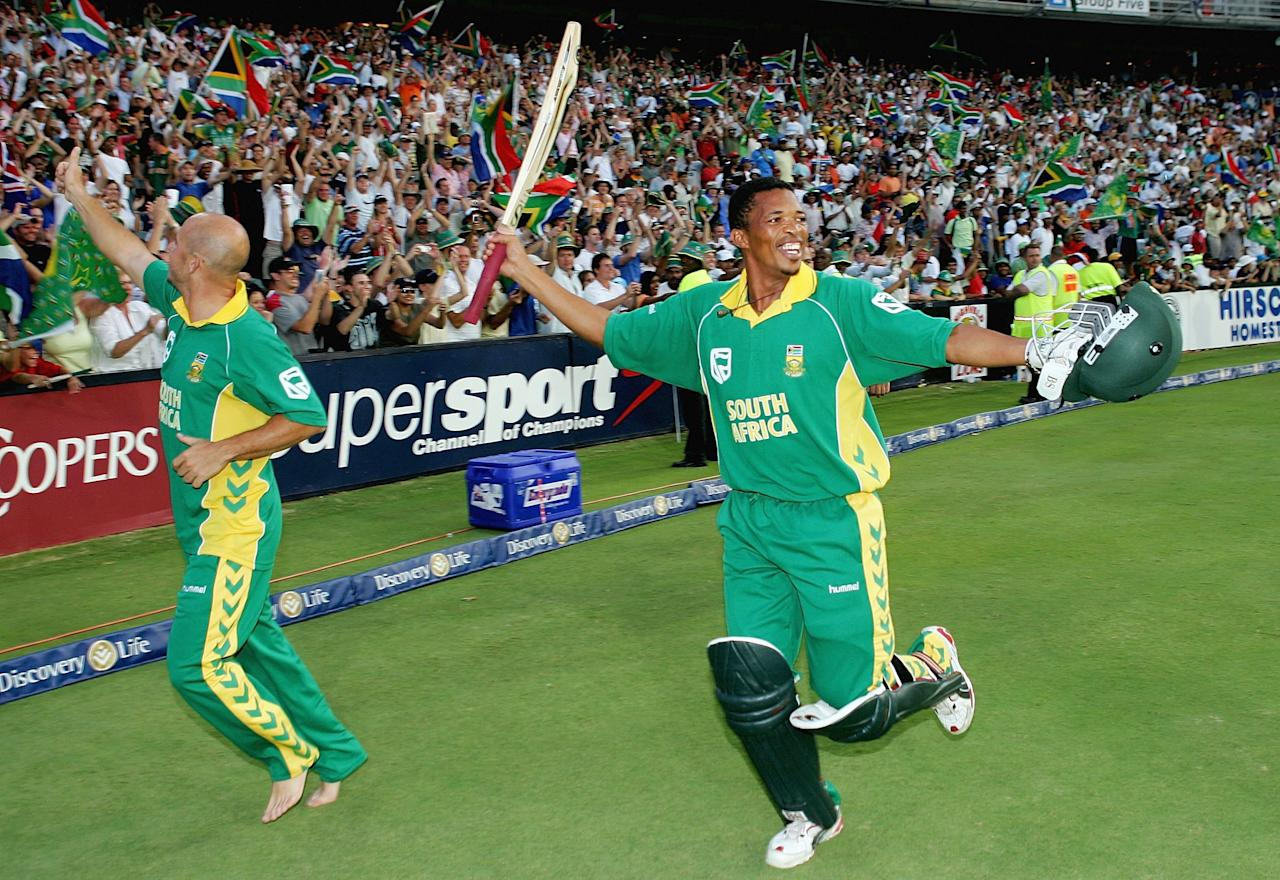 JOHANNESBURG, SOUTH AFRICA - MARCH 12:  Herschelle Gibbs (L) and Makhaya Ntini of South Africa celebrate their team's one wicket victory during the fifth One Day International between South Africa and Australia played at Wanderers Stadium on March 12, 2006 in Johannesburg, South Africa.  (Photo by Hamish Blair/Getty Images)