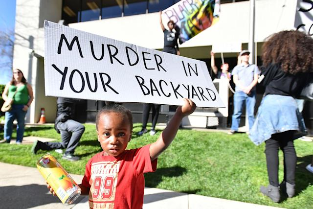 <p>Jayceon Hurtz, 2, holds a sign as Black Lives Matter protesters rally in response to the police shooting of Stephon Clark in Sacramento, Calif., on March 28, 2018. (Photo: Josh Edelson/AFP/Getty Images) </p>