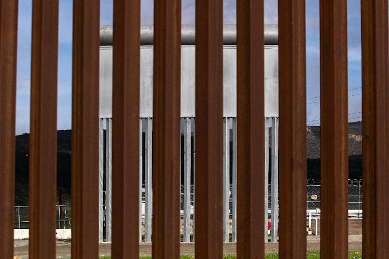A section of the fence on the US border with Mexico as seen from Tijuana, Mexico (AFP Photo/Guillermo Arias)