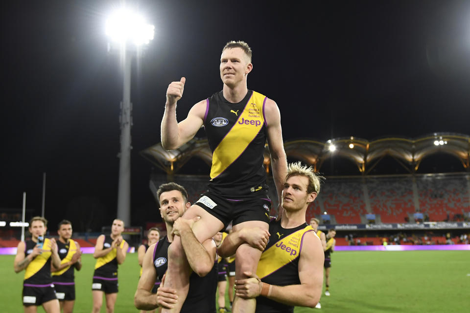 Pictured here, Jack Riewoldt is hoisted up by teammates after the win over Brisbane.
