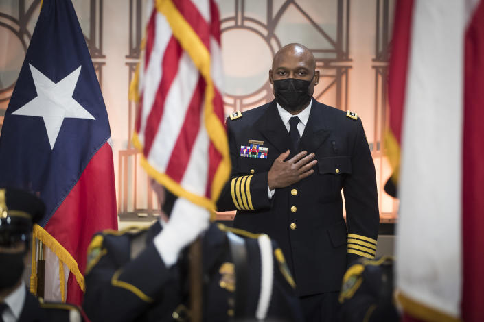 FILE - In this April 5, 2021, file photo, Houston Police Chief New Houston Police Chief Troy Finner stands for the national anthem before being sworn in as HPD's newest leader at City Hall in Houston. (Brett Coomer/Houston Chronicle via AP)