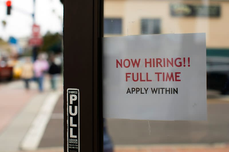 FILE PHOTO: A retail store advertising a full time job on its open door in Oceanside, California