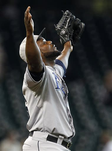 Tampa Bay Rays relief pitcher Fernando Rodney (56) celebrates after defeating the Houston Astros 7-5 in eleven innings during an MLB American League baseball game on Thursday, July 4, 2013, in Houston. (AP Photo/Patric Schneider)