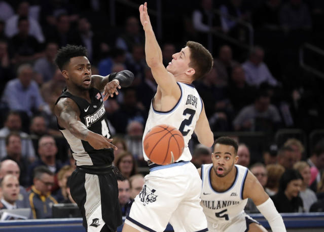 Providence's Maliek White (4) passes away from Villanova's Collin Gillespie (2) during the first half of an NCAA college basketball game in the Big East Conference tournament, Thursday, March 14, 2019, in New York. (AP Photo/Frank Franklin II)