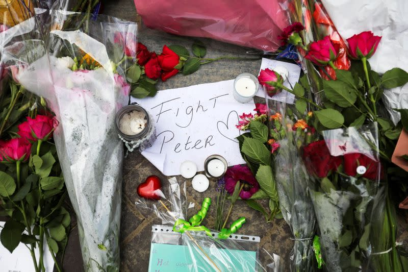 FILE PHOTO: People leave flowers where Dutch crime reporter de Vries has been shot and reported seriously injured in Amsterdam