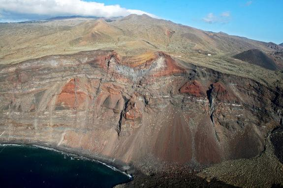 Two monogenetic volcanic cones intersected by a cliff at the western point of El Hierro volcano in the Canary Islands, Spain.
