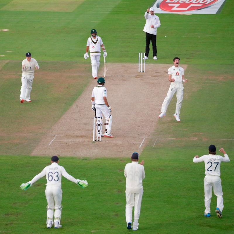 England's James Anderson (CR) celebrates taking the wicket of Pakistan's Babar Azam on the second day of the third Test cricket match between England and Pakistan at the Ageas Bowl in Southampton - Getty Images