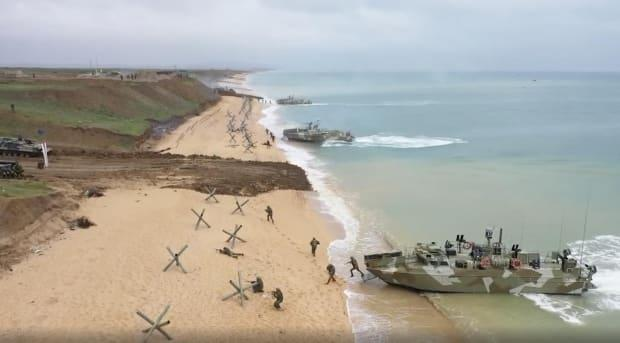 Russian troops that staged a mock amphibious invasion in occupied Crimea are headed back to their home bases.