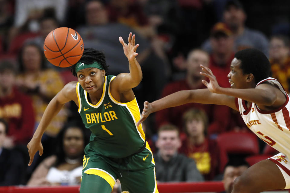 FILE- In this March 8, 2020, file photo, Baylor forward NaLyssa Smith, left, fights for the ball with Iowa State forward Inès Nezerwa, right, during the second half of an NCAA college basketball game in Ames, Iowa. Smith, who led the Big 12 with her 58.6% field goal shooting while averaging 14.3 points and 8.0 rebounds a game last season, is the preseason Big 12 player of the year. (AP Photo/Charlie Neibergall, File)