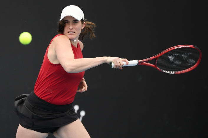 Canada's Rebecca Marino makes a forehand return to Australia's Kimberly Birrell during their first round match at the Australian Open tennis championship in Melbourne, Australia, Monday, Feb. 8, 2021.(AP Photo/Andy Brownbill)