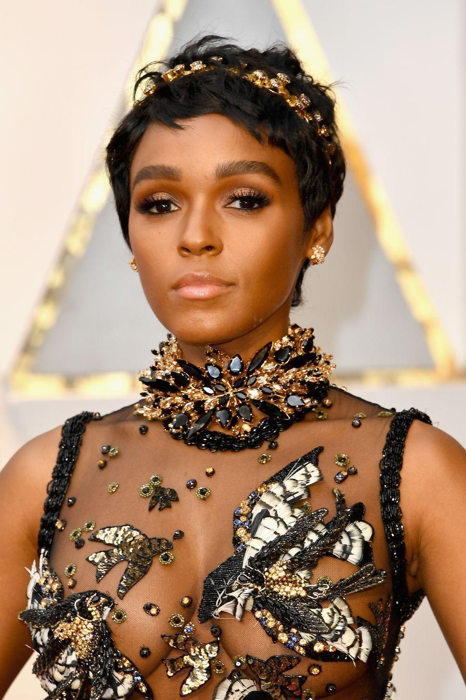"""<p>From hats to safety pins, <strong>Janelle Monae </strong>totally gets how to adorn her tresses with <a href=""""https://www.goodhousekeeping.com/beauty/hair/g30681266/cute-hair-clips-barrettes/"""" rel=""""nofollow noopener"""" target=""""_blank"""" data-ylk=""""slk:hair accessories"""" class=""""link rapid-noclick-resp"""">hair accessories</a>, but this <a href=""""https://www.goodhousekeeping.com/beauty/hair/a26477391/how-to-wear-headband/"""" rel=""""nofollow noopener"""" target=""""_blank"""" data-ylk=""""slk:gilded headband"""" class=""""link rapid-noclick-resp"""">gilded headband</a> is one of our favorites. It's simple, stately and downright gorgeous.</p><p><a class=""""link rapid-noclick-resp"""" href=""""https://www.amazon.com/Goddess-Headband-Costumes-Wedding-Headpiece/dp/B07CVV63W5/?tag=syn-yahoo-20&ascsubtag=%5Bartid%7C10055.g.35472268%5Bsrc%7Cyahoo-us"""" rel=""""nofollow noopener"""" target=""""_blank"""" data-ylk=""""slk:SHOP GILDED HEADBAND"""">SHOP GILDED HEADBAND</a></p>"""
