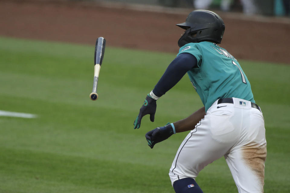 Seattle Mariners' Kyle Lewis tosses his bat after hitting a single against the Oakland Athletics during the fifth inning of a baseball game, Friday, July 31, 2020, in Seattle. (AP Photo/Ted S. Warren)