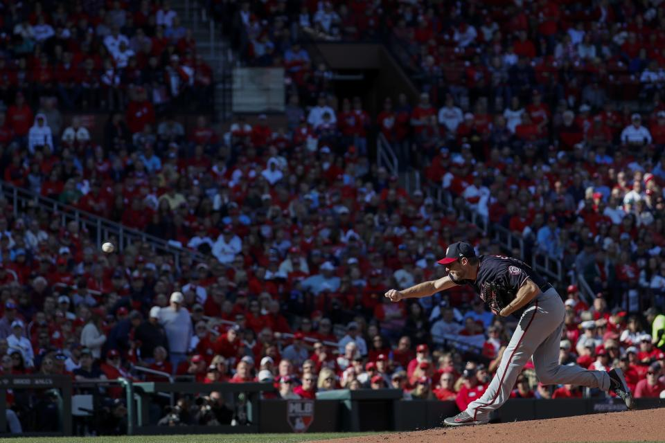 Washington Nationals starting pitcher Max Scherzer throws during the first inning of Game 2 of the baseball National League Championship Series against the St. Louis Cardinals Saturday, Oct. 12, 2019, in St. Louis. (AP Photo/Jeff Roberson)
