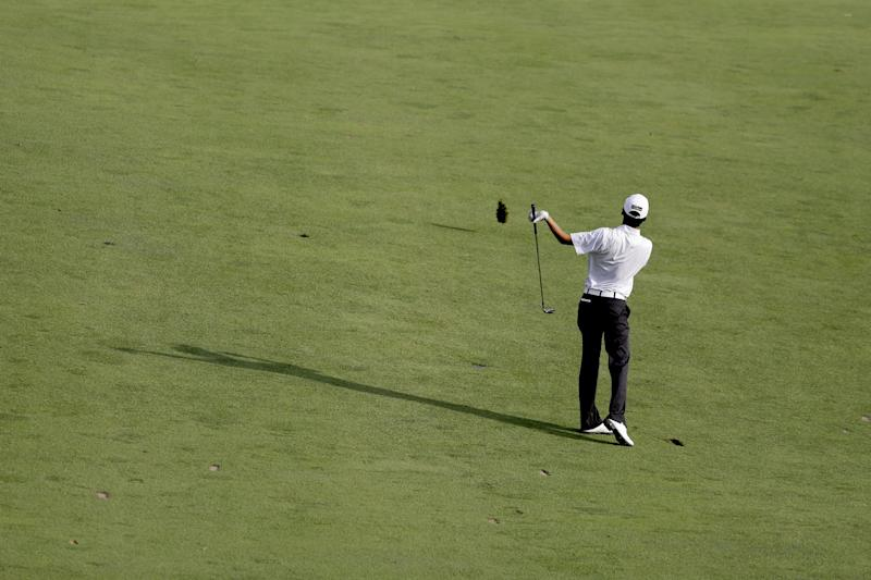 Michael Kim hits down the 18th fairway during the third round of the U.S. Open golf tournament at Merion Golf Club, Saturday, June 15, 2013, in Ardmore, Pa. (AP Photo/Darron Cummings)