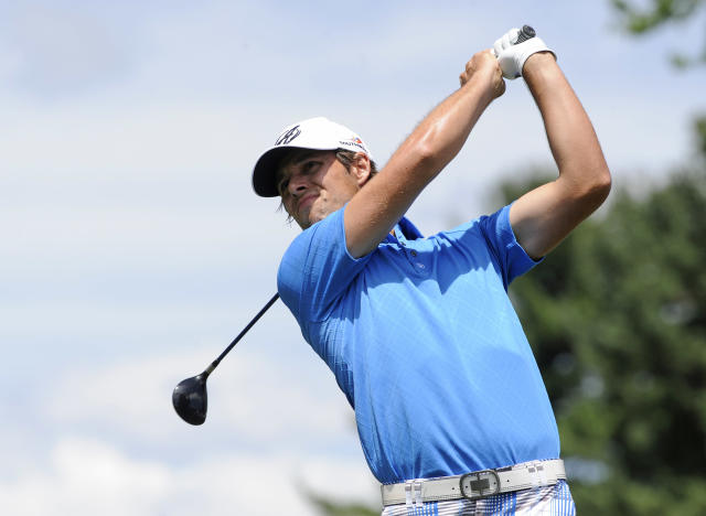 Aaron Baddeley watches his drive on the second hole during the third round of the Travelers Championship golf tournament in Cromwell, Conn., Saturday, June 21, 2014. (AP Photo/Fred Beckham)