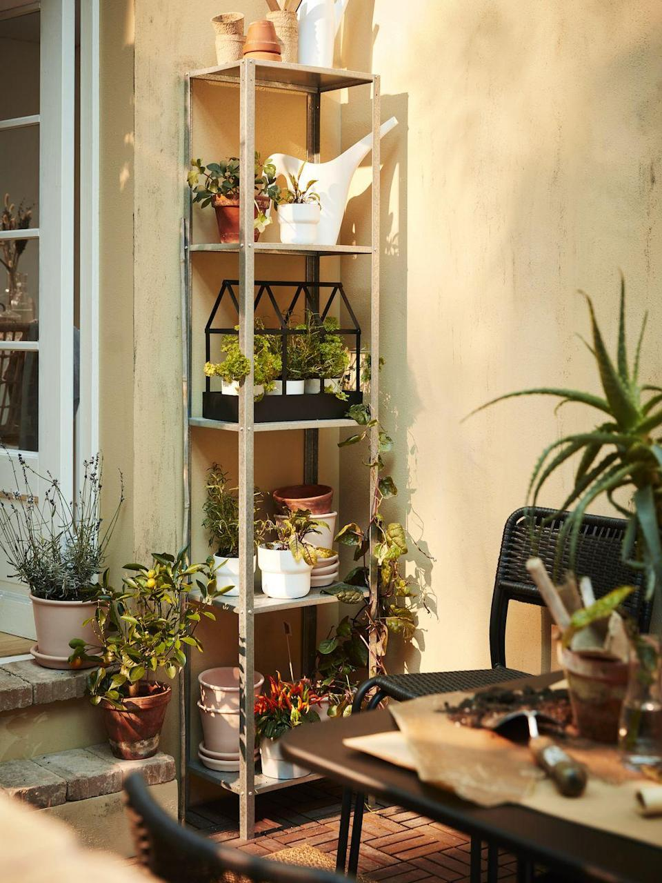 """<p><a href=""""https://www.housebeautiful.com/uk/garden/designs/how-to/a781/balcony-garden-guide/"""" rel=""""nofollow noopener"""" target=""""_blank"""" data-ylk=""""slk:Balcony gardens"""" class=""""link rapid-noclick-resp"""">Balcony gardens</a> were all the rage on Instagram last year, with more households transforming small spaces into urban jungles. </p><p>'Limited space shouldn't be a hinderance when creating your personal oasis, playing with storage solutions with different heights will help maximise what you have available. </p><p>'For example, the HYLLIS shelving unit is sturdy and lightweight. Simply stack pots of different sizes and fill them with your favourite herbs, flowers and plants to create a lush, zen spot.'</p>"""