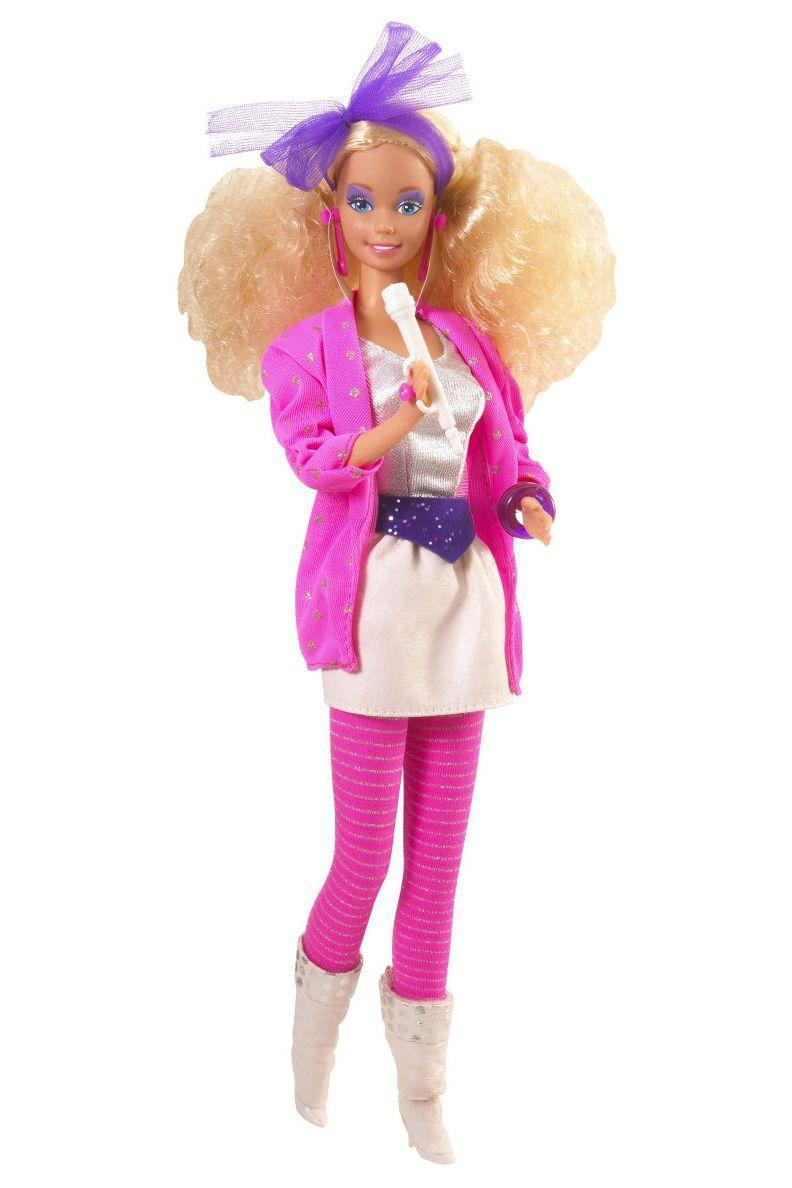"<p>Barbie debuts her new band, Barbie and the Rockers, and arguably her most '80s look yet. From the big hair to the shoulder pads, wide belt to the slouchy boots, she is wearing all the trends. </p><p><a href=""http://www.goodhousekeeping.com/beauty/fashion/tips/g885/fashion-1986/"" rel=""nofollow noopener"" target=""_blank"" data-ylk=""slk:Take a look back at 1986 fashion »"" class=""link rapid-noclick-resp""><em>Take a look back at 1986 fashion »</em></a></p>"